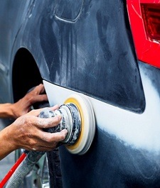 body shop in Great Dunmow and Essex - mechanic sanding car panel